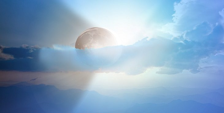 Image of a glorious eclipse with the light and the shadow to represent the Dance Of Light And Dark.