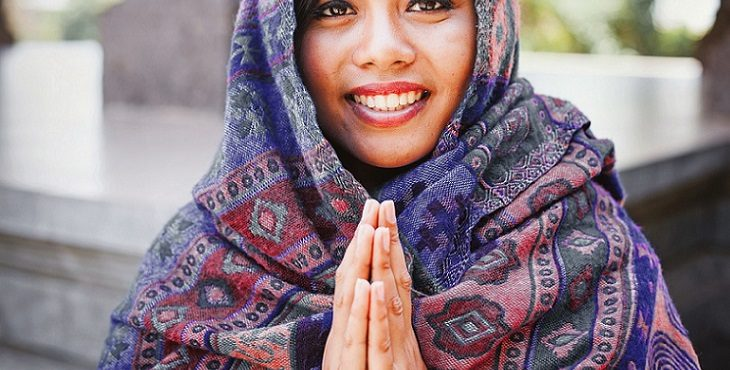 Image of a beautiful Indian woman in a namaste greeting hand gesture. The True Meaning Of Namaste