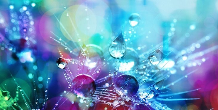 Abstract image of water droplets with pastel orbs in the background. Light Wave Archive #4