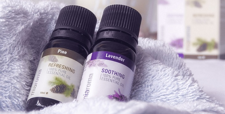 Image of 2 small bottles of essential oils lying on a soft towel. How To Work With Herbs And Essential Oils In Ascension