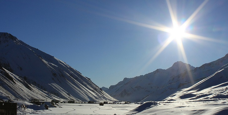 Image of snow-covered mountains and landscape during the winter with the shining sun overhead. Energetic Dynamics Of Disease