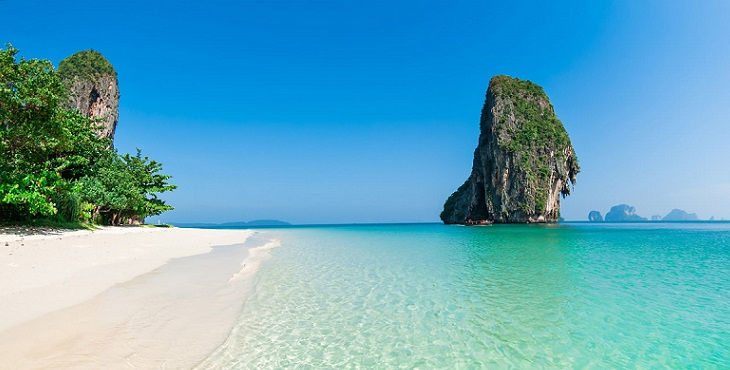 Image of a beautiful beach in Thailand with a huge stone structure in the middle of aqua water. Earth Archive #1