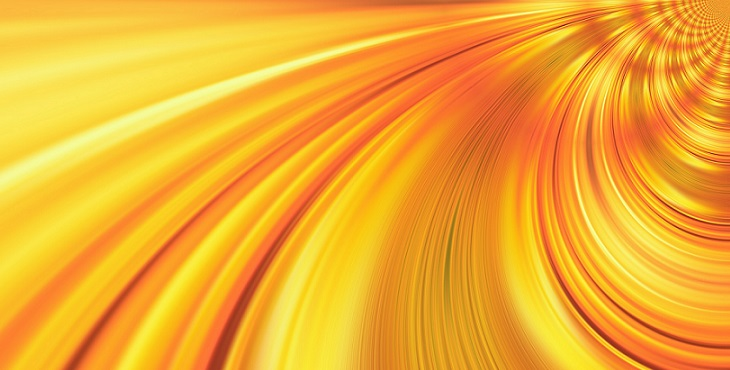 Image of golden waves with red highlights leading to the core of the source. Light Wave Archive #17