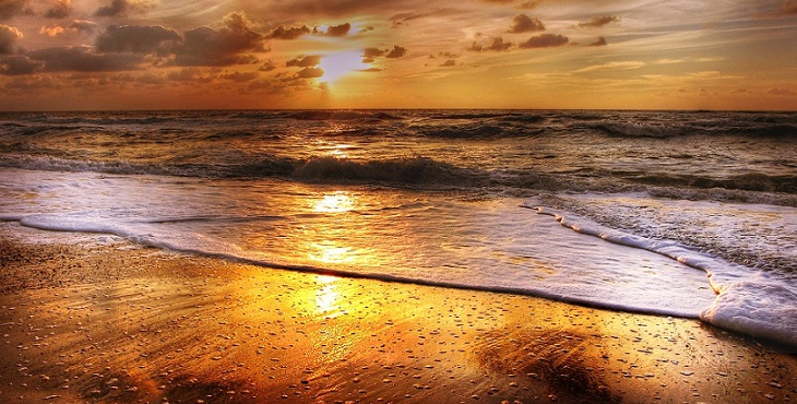 Image of a beautiful golden sunset at the beach. Incantations for the Divine Partner